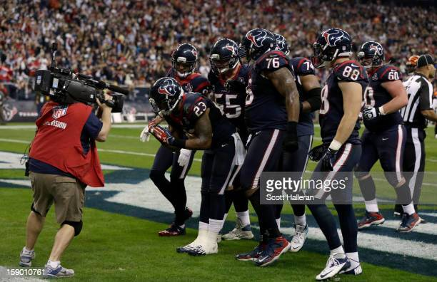 Arian Foster of the Houston Texans celebrates after he scored a 1yard rushing touchdown in the third quarter against the Cincinnati Bengals during...