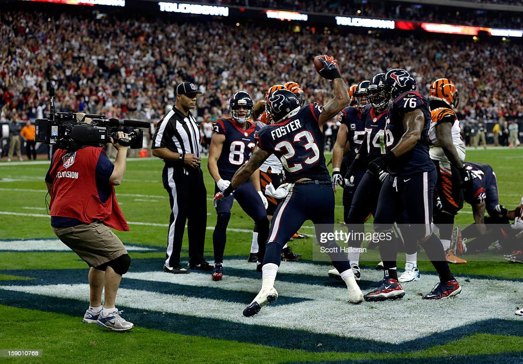 Arian Foster #23 of the Houston Texans celebrates after he scored a 1-yard rushing touchdown in the third quarter against the Cincinnati Bengals during their AFC Wild Card Playoff Game at Reliant Stadium on January 5, 2013 in Houston, Texas.