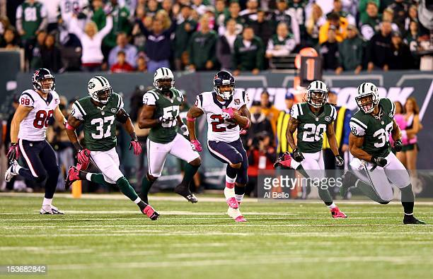 Arian Foster of the Houston Texans runs for 46yards in the first quarter against the New York Jets at MetLife Stadium on October 8 2012 in East...