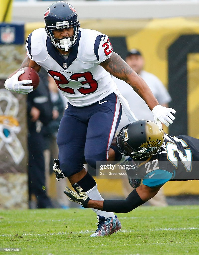 Arian Foster #23 of the Houston Texans runs past Aaron Calvin #22 of the Jacksonville Jaguars during the game at EverBank Field on December 7, 2014 in Jacksonville, Florida.