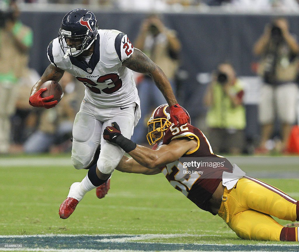 Arian Foster #23 of the Houston Texans rushes past Keenan Robinson #52 of the Washington Redskins in the fourth quarter at Reliant Stadium on September 7, 2014 in Houston, Texas.