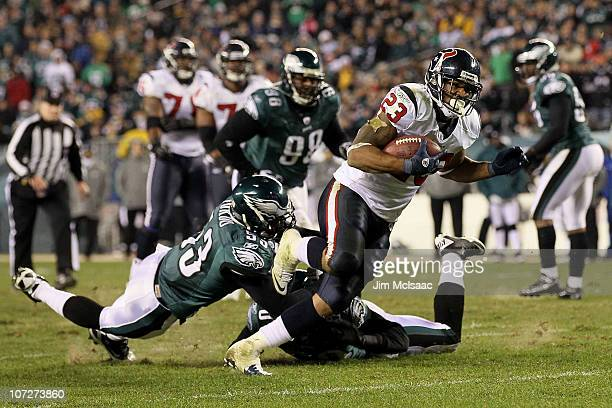 Arian Foster of the Houston Texans scores on a 14-yard touchdown reception in the third quarter against Nate Allen of the Philadelphia Eagles at...