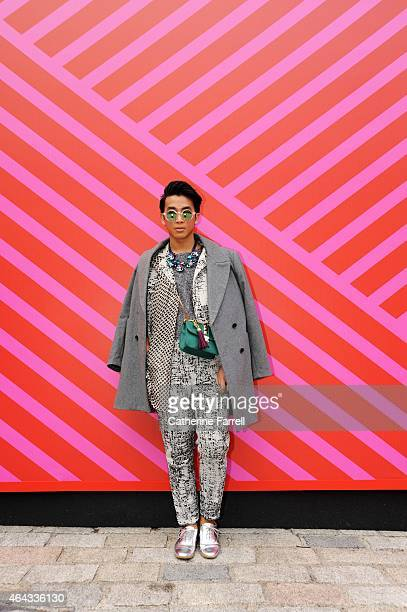 Arian Humirang stylist and style blogger wearing a Rohmir scarf Topshop top two piece printed cotton suit from Asos accessorised with sunglasses and...