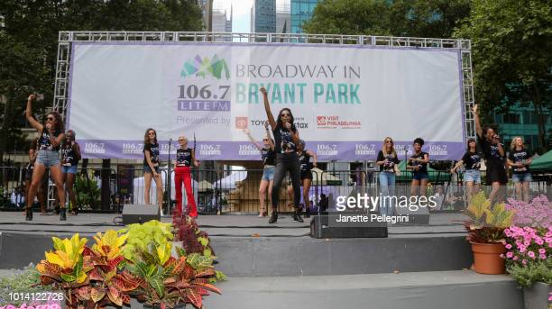 Ariana DeBose Christina Acosta Robinson and Storm Lever perform with the cast of 'Summer The Donna Summer Musical' at 1067 LITE FM's Broadway in...