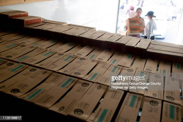 Ariana Gonzalez of Garden Grove and Kiana Cervantes of Orange help stack Peanut Butter Patties in the back of a moving truck part of a 570 case order...