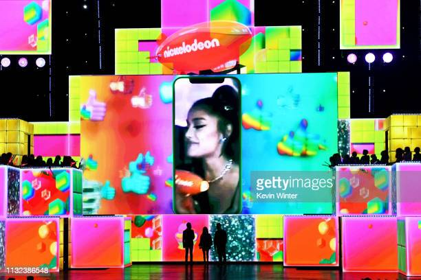 Ariana Grande accepts the awards for Favorite Female Artist and Favorite Song for 'Thank U Next' during Nickelodeon's 2019 Kids' Choice Awards at...