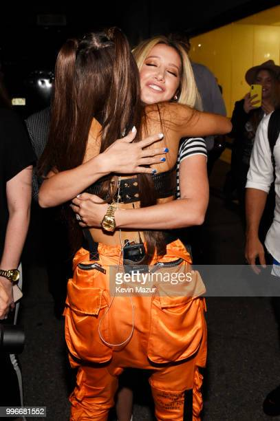 Ariana Grande and Ashley Tisdale embrace backstage at the Amazon Music Unboxing Prime Day event on July 11 2018 in Brooklyn New York