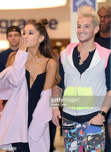 Ariana Grande and Frankie Grande attend a photocall to support the launch of her debut fragrance Ari by Ariana Grande and also meet and greet her...