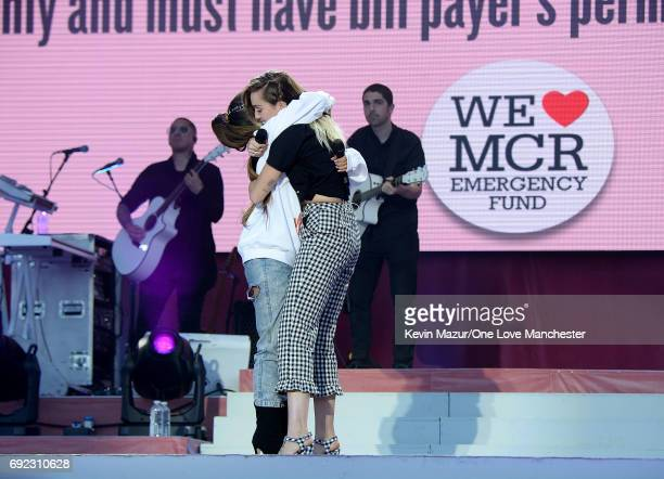 Ariana Grande and Miley Cyrus embrace on stage during the One Love Manchester Benefit Concert at Old Trafford Cricket Ground on June 4 2017 in...
