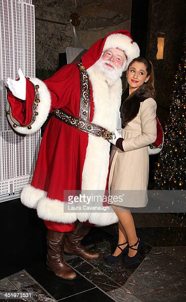 Ariana Grande and Santa Claus visit at The Empire State Building on November 25 2013 in New York City