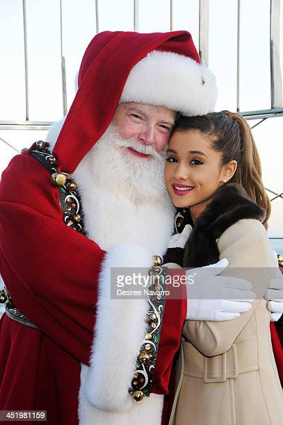 Ariana Grande and Santa Claus visit The Empire State Building in honor of the 87th Annual Macy's Thanksgiving Parade on November 25 2013 in New York...