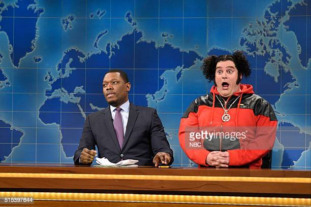 LIVE 'Ariana Grande' Episode 1698 Pictured Michael Che and Bobby Moynihan as Riblet during the Weekend Update on March 12 2016