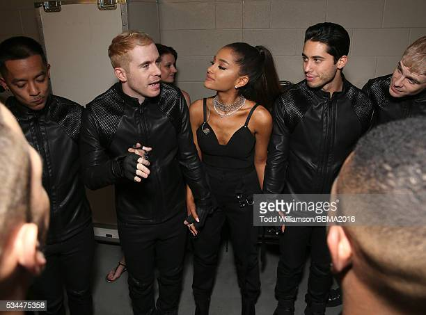 Ariana Grande in a prayer circle with her dancers backstage at the 2016 Billboard Music Awards at the TMobile Arena on May 22 2016 in Las Vegas Nevada