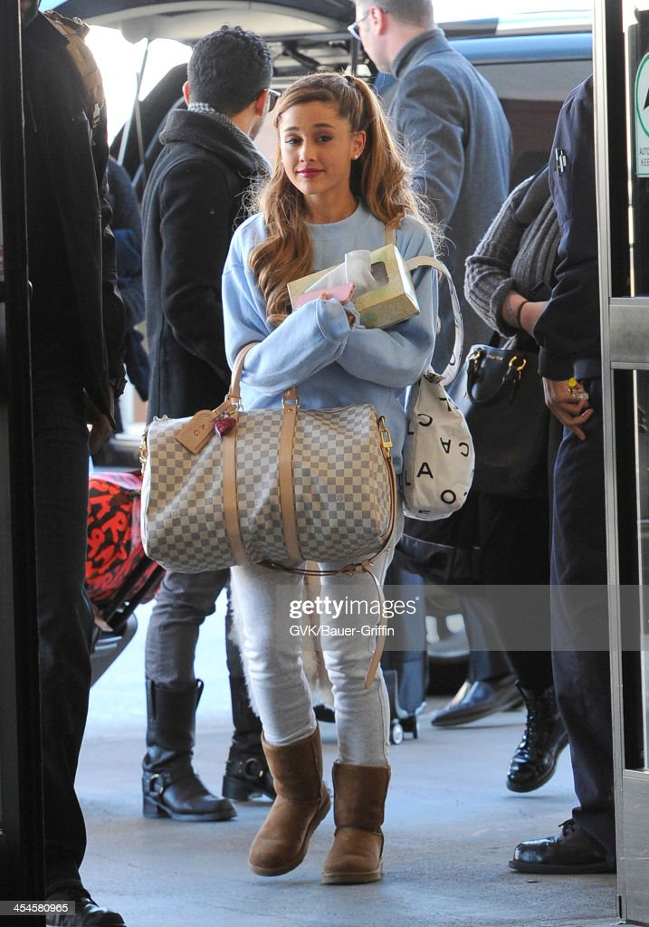 Ariana Grande is seen arriving at LAX airport on December 09, 2013 in Los Angeles, California.