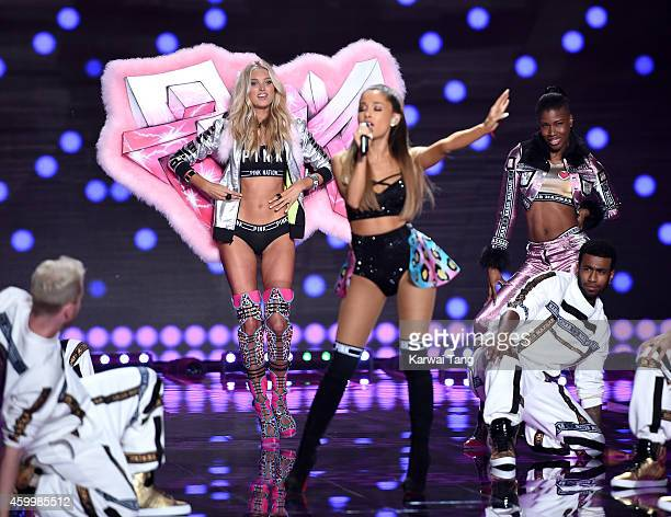 Ariana Grande performs as Elsa Hosk walks the runway at the annual Victoria's Secret fashion show at Earls Court on December 2 2014 in London England