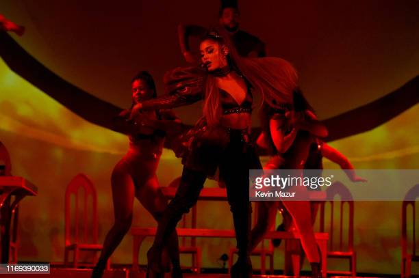 """Ariana Grande performs on stage during her """"Sweetener World Tour"""" at The O2 Arena on August 20, 2019 in London, England."""