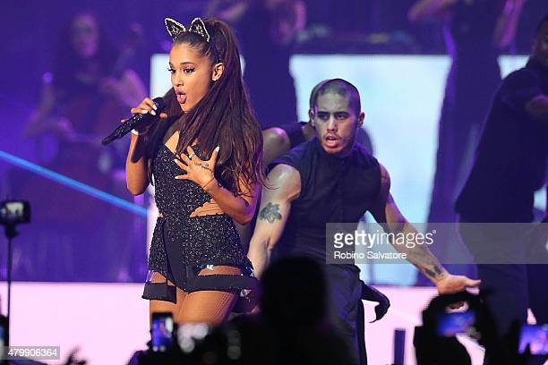 Ariana Grande performs on stage with her backing dancer and rumored boyfriend Ricky Alvarez on June 25 2015 in Milan Italy