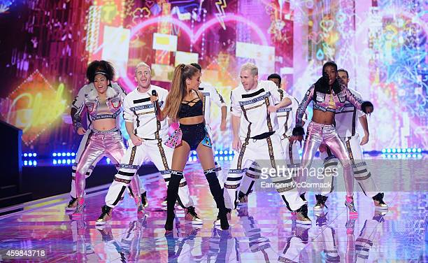 Ariana Grande performs on the runway at the annual Victoria's Secret fashion show at Earls Court on December 2 2014 in London England