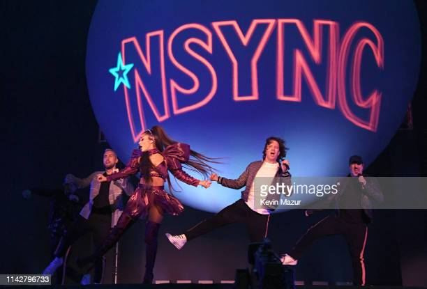 Ariana Grande performs with members of NSYNC Chris Kirkpatrick Lance Bass JC Chasez and Joey Fatone on Coachella Stage during the 2019 Coachella...