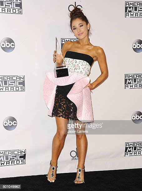 Ariana Grande poses in the press room at the 2015 American Music Awards at Microsoft Theater on November 22 2015 in Los Angeles California