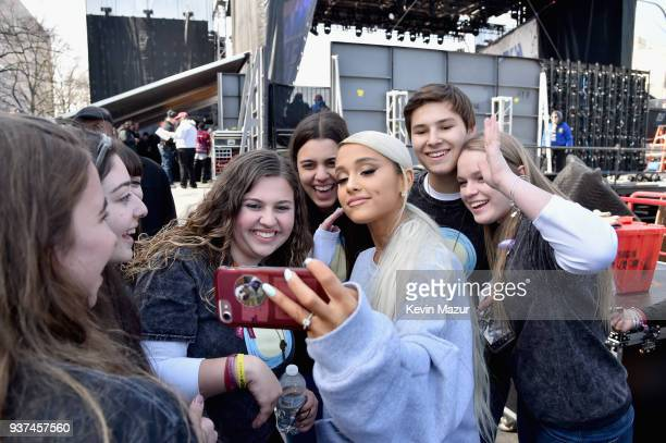 Ariana Grande poses with students at March For Our Lives on March 24 2018 in Washington DC