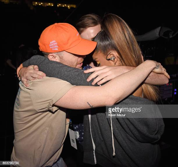 Ariana Grande prays backstage before performing at 'A Concert for Charlottesville' at University of Virginia's Scott Stadium on September 24 2017 in...