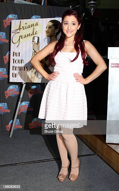Ariana Grande promotes her new Universal/Republic cd 'Put Your Hearts Up' as she visits Planet Hollywood Times Square on December 22 2011 in New York...