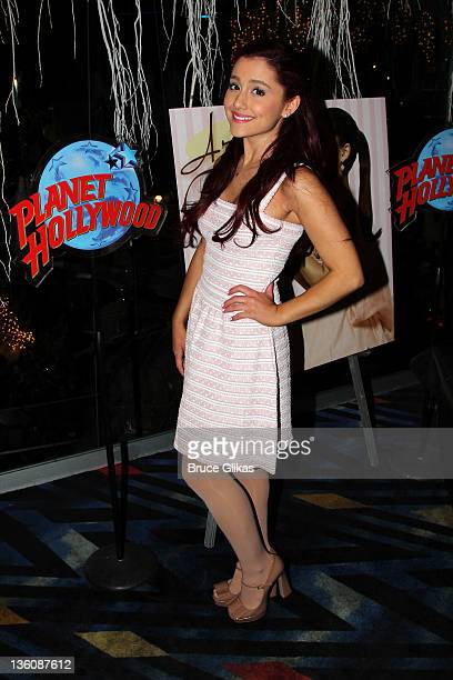 Ariana Grande promotes her new Universal/Republic cd Put Your Hearts Up as she visits Planet Hollywood Times Square on December 22 2011 in New York...