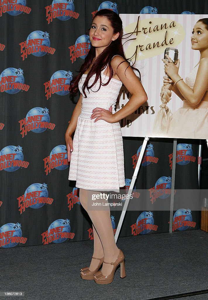 Ariana Grande Visits Planet Hollywood : News Photo