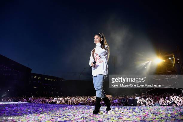 Ariana Grande wipes away a tear as she performs on stage during the One Love Manchester Benefit Concert at Old Trafford Cricket Ground on June 4,...