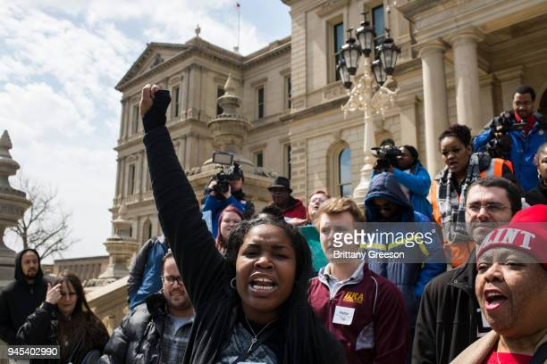 Ariana Hawk of Flint Michigan leads a chant during a protest on the steps of the Michigan State Capitol on April 11 2018 in Lansing Michigan The...