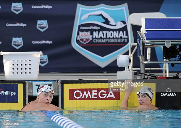 Ariana Kukors and Morgan Scroggy look to the clock for results in the Women 200 LC Meter IM Final at the William Woollett Jr Aquatics Complex on...