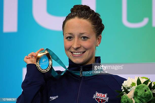 Ariana Kukors of USA poses with her Gold medal after winning the Women's 100m Individual Medley final on day three of the 10th FINA World Swimming...
