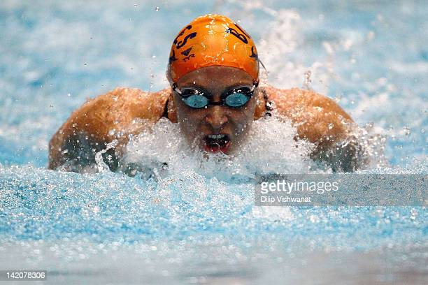 Ariana Kukors swims in the women's 100 meter butterfly finals during day one of the 2012 Indianapolis Grand Prix at the Indiana University Natatorium...