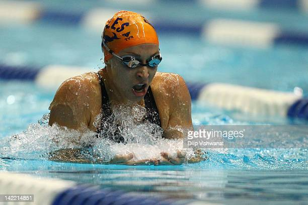 Ariana Kukors swims in the women's 200 meter individual medley finals during day three of the Indy Grand Prix @ the Nat at the Indiana University...