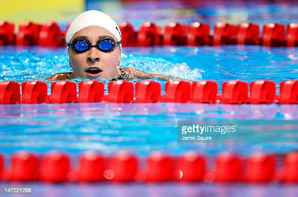 Ariana Kukors swims to the side of the pool after she competed in preliminary heat 13 of the Women's 200 m Individual Medley during Day Three of the...