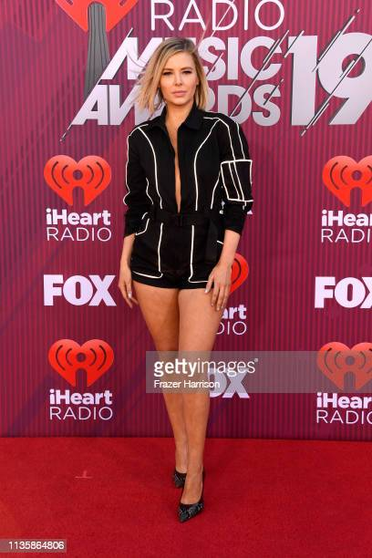 Ariana Madix attends the 2019 iHeartRadio Music Awards which broadcasted live on FOX at Microsoft Theater on March 14, 2019 in Los Angeles,...