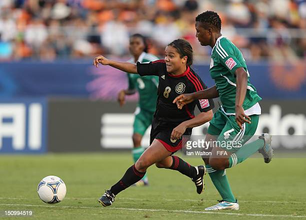 Ariana Martinez of Mexico challenges Ugo Njoku of Nigeria during the FIFA U20 Women's World Cup QuarterFinal match between Nigeria and Mexico at the...