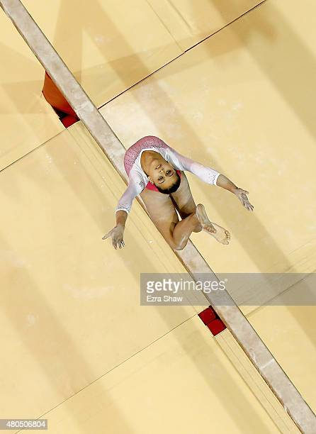 Ariana Orrego Martinez of Peru competes on the balance beam during the women's artistic gymnastics team final and qualifications on Day 2 of the...