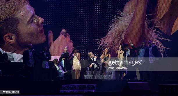 Ariana performs with dancers and projection screen