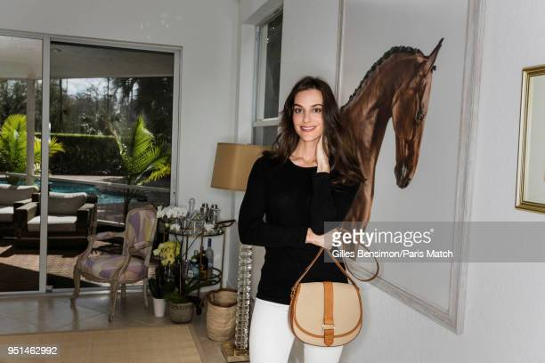 Ariana Rockefeller is photographed for Paris Match at home holding in her hand a saddleshaped bag she created for the Longines Masters February 8...