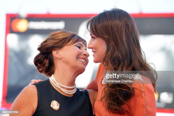 Ariane Ascaride and Anais Demoustier walk the red carpet ahead of the 'The House By The Sea ' screening during the 74th Venice Film Festival at Sala...