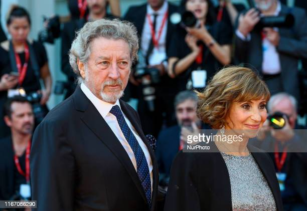 Ariane Ascaride and Robert Guediguian walks the red carpet ahead of the closing ceremony of the 76th Venice Film Festival at Sala Grande on September...