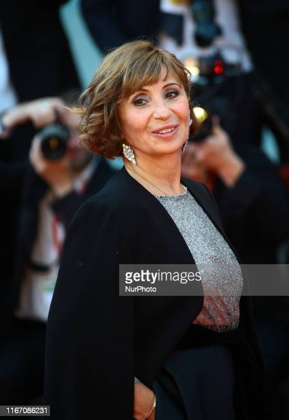 Ariane Ascaride walks the red carpet ahead of the closing ceremony of the 76th Venice Film Festival at Sala Grande on September 07 2019 in Venice...