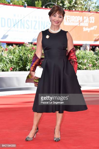 Ariane Ascaride walks the red carpet ahead of the 'The House By The Sea ' screening during the 74th Venice Film Festival at Sala Grande on September...