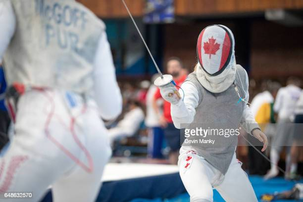 Ariane Bilodeau of Canada fences Sofia McGoff of Puerto Rico in the Junior Women's Foil competition at the Cadet and Junior PanAmerican Fencing...