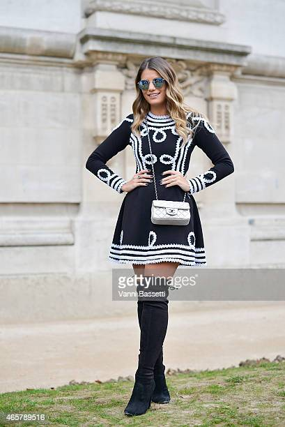 Ariane Canovas poses wearing a Bambola dress and Chanel bag on Day 8 of Paris Fashion Week Womenswear FW15 on March 10 2015 in Paris France
