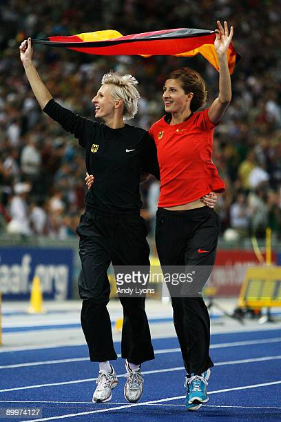 Ariane Friedrich of Germany and Meike Kröger of Germany do a lap of honour after the women's High Jump Final during day six of the 12th IAAF World...