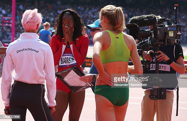 Ariane Friedrich of Germany Brigetta Barrett of the United States and Airine Palsyte of Lithuania in discussion in the Women's High Jump...