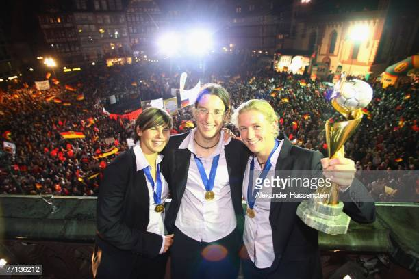 Ariane Hingst Birgit Prinz and Kerstin Stegemann of the German Womens National Soccer Team celebrates at the city hall 'Roemer' after returning home...